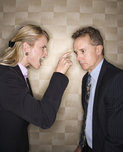 Businesswoman Reprimanding Businessman